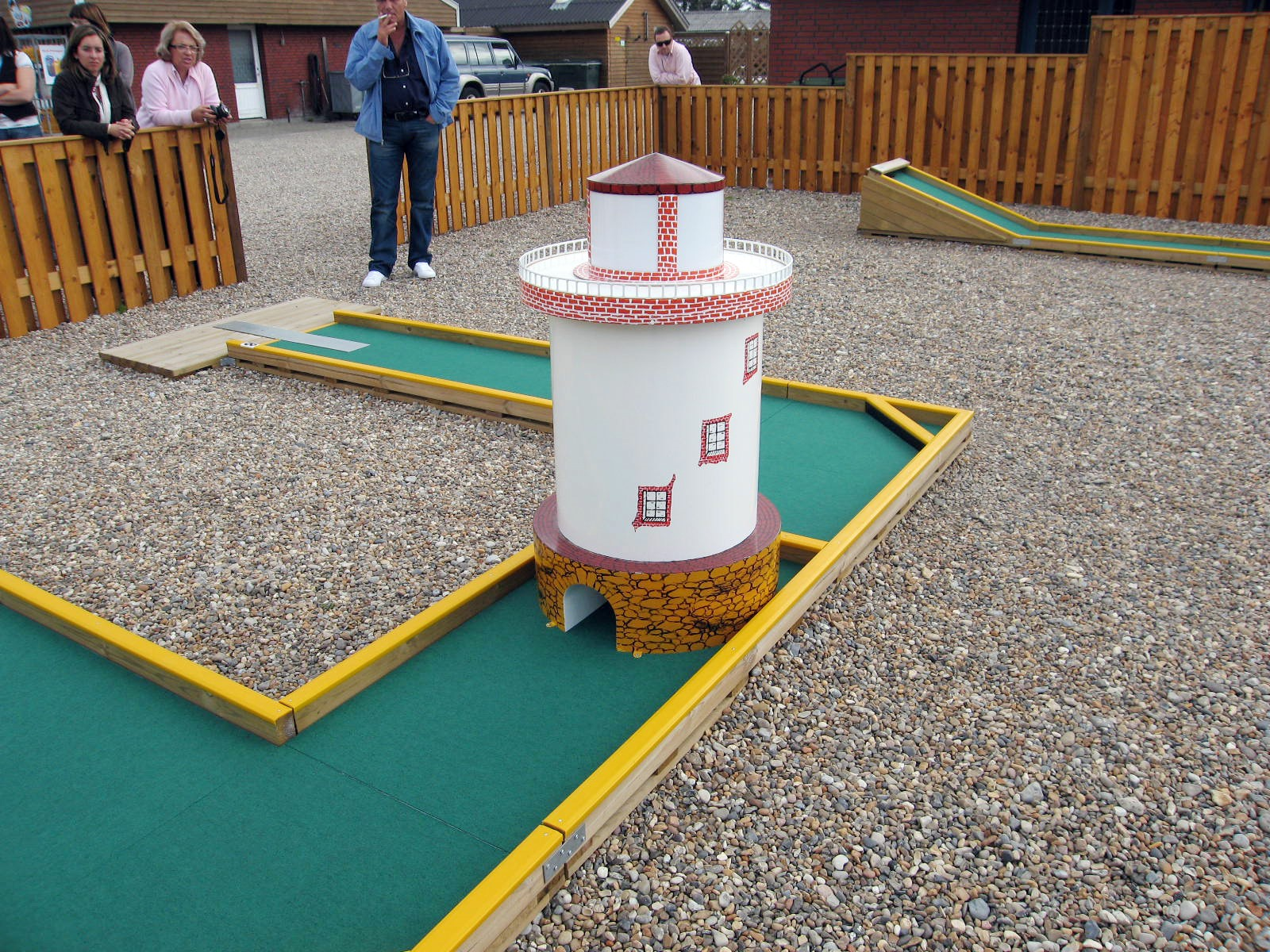 Minigolf with lighthouse obstacle