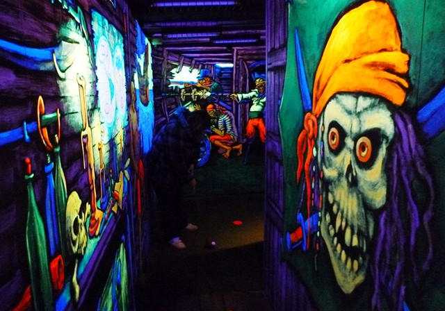 Blacklight paintings inside the pirate ship