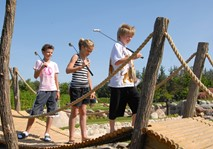 Bridge with children walking over it at adventure golf