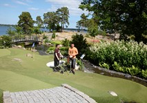 Men standing at adventure golf fairway