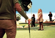 Young girl at adventure golf hole 7
