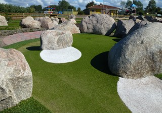 Large stones around the adventure golf hole