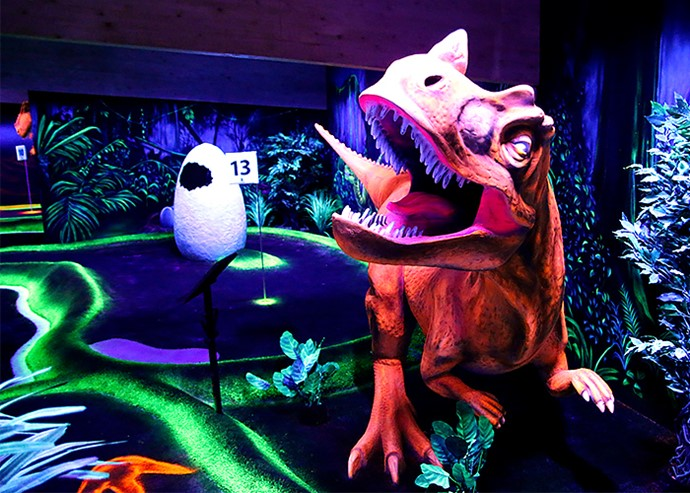 Blacklight dinosaur at adventure golf course