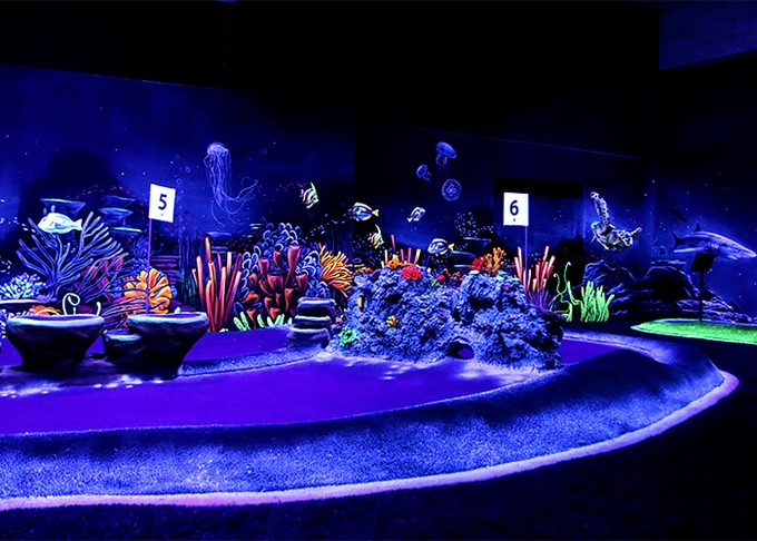 Glowing adventure golf reef with fish
