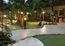 Play at night with the adventure golf indoors
