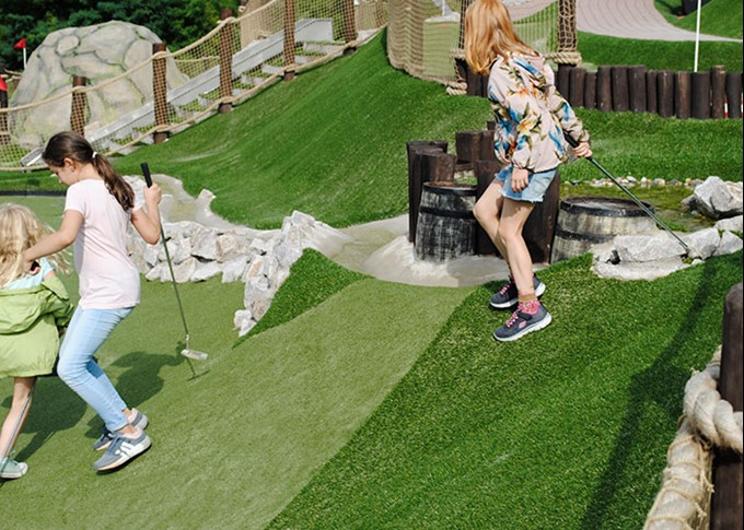 Kids playing adventure golf