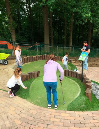 Family playing adventure golf