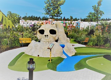 View of the Pirate Adventure Golf course at the LEGOLAND Holiday Village with the 142-room Pirate Island hotel in the background.